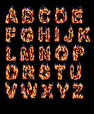 Alphabets with fire. On black background Stock Images