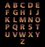 Alphabets in Galaxy Style Texture on Black Background Stock Images