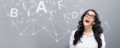 Alphabets with happy young businesswoman Stock Image