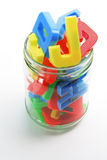 Alphabets in Jar. On Seamless Background Royalty Free Stock Photos