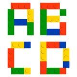 Alphabetset gebildet von den Spielzeugaufbau-Ziegelsteinblöcken Stockfotos