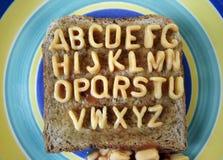 Alphabetti spaghetti. The alphabet made from spaghetti pasta shapes - wide angle, funny huh royalty free stock photos