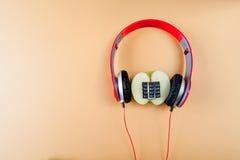 Alphanumeric apple and headphones Stock Photography