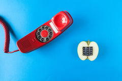 Alphanumeric apple and red telephone old royalty free stock photo