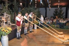 Alphorn blowers at Oktoberfest Royalty Free Stock Image