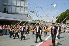 Alphorn parade. Parade of Swiss alphorn players walking along the streets of Luzern, Switzerland. A folkloristic event called Jodlerfest which took place on 27 Stock Photo