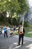 Alphorn player in Lucern, Switzerland Stock Image