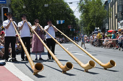 Alphorn players. Group of Swiss alphorn players exhibiting themselves in the streets of Luzern, Switzerland. A folkloristic event called Jodlerfest which took Royalty Free Stock Photos