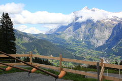 Alphorns with mountains at the background in Switzerland. Swiss alphorns with the Wetterhorn at the background in Berner Oberland, Switzerland. Mountain stock photography