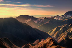 Alpi Apuane mountains and marble quarry view at sunset. Carrara Stock Photo