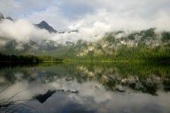 Alpi con il Rainbow Immagine Stock