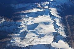 Alpi di inverno nel giorno soleggiato Immagini Stock Libere da Diritti