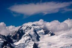 Alpi e nubi del sud - Nuova Zelanda Fotografia Stock