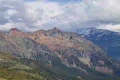 Alpi e nuvole del paesaggio della montagna Immagine Stock Libera da Diritti