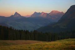 Alpi nel tempo di tramonto Fotografia Stock