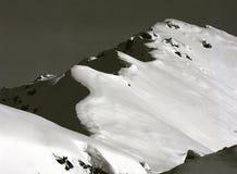 Alpi in neve fresca, che può trasformarsi in in una valanga Immagine Stock Libera da Diritti
