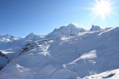 Alpi piene di sole Fotografia Stock