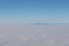 Alpi slovene sopra le nuvole Fotografia Stock