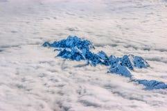 Alpi sopra le nuvole Fotografia Stock Libera da Diritti
