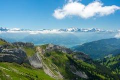 Alpi svizzere sopra le nuvole Immagine Stock Libera da Diritti