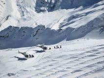 Alpi svizzere St Moritz di corsa con gli sci dell'elicottero Immagine Stock
