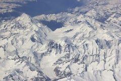 Alpi - vista aerea dalla finestra dell'aeroplano Fotografie Stock