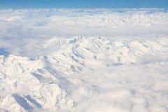 Alpi - vista aerea dalla finestra dell'aeroplano Immagine Stock