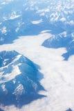 Alpi - vista aerea dalla finestra dell'aeroplano Immagini Stock