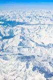 Alpi - vista aerea dalla finestra dell'aeroplano Immagini Stock Libere da Diritti