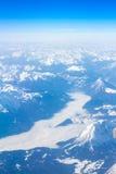 Alpi - vista aerea dalla finestra dell'aeroplano Immagine Stock Libera da Diritti