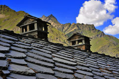 Alpien roof with chimneys in mountains stock photo