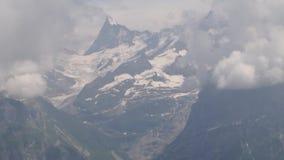 Alpiene pieken landskape achtergrond Jungfrau, Bernese-hoogland Alpen, toerisme en avonturen wandelingsconcept stock video