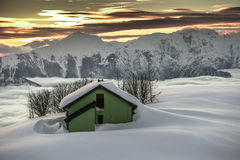 Alpin hut in the snow Stock Images