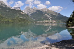 Alpin Lake Molveno, Italy. Molveno is located in Italy, Europe.  Images shows  Molveno Lake in the front, silent water with small waves in the middle and Royalty Free Stock Photo