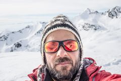 Alpin skier taking selfie Royalty Free Stock Photography