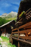 Alpine architecture, Alpe Devero. Italian Alps. Typical alpine wood and stone architecture. Alpe Devero resort, Piemonte, Italy stock images