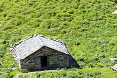 Alpine barn. Ancient barn built with local stone in the Swiss alps stock images