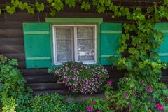 House window. Alpine Bavarian house Façade with window. traditional Bavarian house in the Alps, Walchensee, Germany, 2017 royalty free stock images