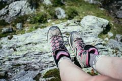 Alpine boots in foreground, idyllic mountain landscape in the blurry background. Cut out of a woman in hiking boots who is enjoying the idyllic mountain stock photos