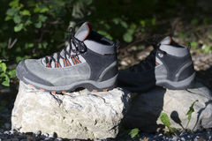 Alpine boots on a rock Stock Image