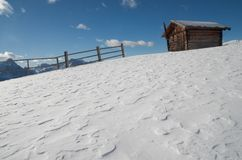 Alpine cabin. Wooden hut in the snow at austrian Alps Royalty Free Stock Images