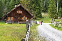 Alpine cabin and Hiker in Weisspriachtal in Lungau, Austria Royalty Free Stock Photo