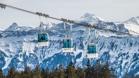 Alpine cable car and mountains