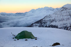 Alpine camping in high snow-covered mountains Stock Photos