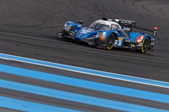 Alpine car takes a turn on Paul Ricard track. LE CASTELLET, FRANCE, April 7, 2018 : Racing cars and teams during the training sessions for World Endurance Car royalty free stock images