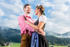 Alpine cattle farmers on mountain meadow Stock Photography