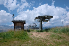 Alpine chair lift in a summer landscape Royalty Free Stock Photos