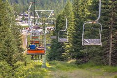 Alpine Chairlift hikers Royalty Free Stock Photography