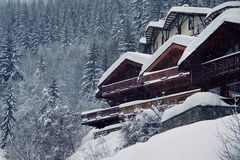 Alpine chalet. Traditional mountain chalet in snowy weather stock photography