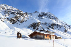 Alpine chalet house and mountain panorama with snow in winter in Stubai Alps. Austria royalty free stock images